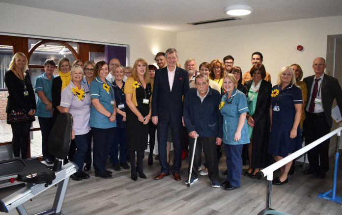 Football legend cuts the ribbon on new hospice gym